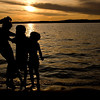 August 2, 2009<br /> Noogies.......Traverse City, Michigan - A good time was had by all. <br /> <br />  This started as a sweet little shot of my daughter Jill, and 3 of her boys giving me a silhouette in the sunset and ended with, lets give Mommy a noogie.