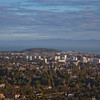 From the western hills, viewing Hillsborough and San Mateo down to San Mateo's downtown area, leading to Coyote Point Recreation Area and the Bay.