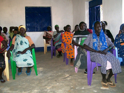 Women attend a class in basic literacy at the center.
