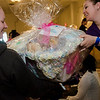 Katelyn Turk receives a raffle basket from Jillian Bastein during the North Central Massachusetts Community Baby Shower hosted by MOC's Women, Infants and Children program and the Gardner Visiting Nurses Association Healthy Families at the Leominster Elks on Wednesday, April 26, 2017. SENTINEL & ENTERPRISE / Ashley Green