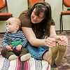 Owen Cross takes part in a baby yoga class with mom Holly during the North Central Massachusetts Community Baby Shower hosted by MOC's Women, Infants and Children program and the Gardner Visiting Nurses Association Healthy Families at the Leominster Elks on Wednesday, April 26, 2017. SENTINEL & ENTERPRISE / Ashley Green