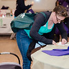 Megan Clawson, of Worcester, fills out raffle tickets during the North Central Massachusetts Community Baby Shower hosted by MOC's Women, Infants and Children program and the Gardner Visiting Nurses Association Healthy Families at the Leominster Elks on Wednesday, April 26, 2017. SENTINEL & ENTERPRISE / Ashley Green