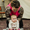 Six-month-old Ambrielle takes part in a baby yoga class with mom Heather Barry during the North Central Massachusetts Community Baby Shower hosted by MOC's Women, Infants and Children program and the Gardner Visiting Nurses Association Healthy Families at the Leominster Elks on Wednesday, April 26, 2017. SENTINEL & ENTERPRISE / Ashley Green