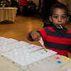 Frankie Mateo, 4, enjoys a lolipop during the North Central Massachusetts Community Baby Shower hosted by MOC's Women, Infants and Children program and the Gardner Visiting Nurses Association Healthy Families at the Leominster Elks on Wednesday, April 26, 2017. SENTINEL & ENTERPRISE / Ashley Green