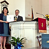 Handing over a State Proclamation is State Rep Sheila Harrington after she spoke, to Co-Chair of the Community Church of Pepperell 100th Anniversary Committee, Mike Resch. SUN/David H. Brow