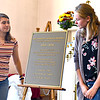Looking at the 100th Anniversary Commemoration Plaque after unvailing it is L-R, Grace Audelle 16 of Ayer and Jessie Nadeau 15 of Pepperell. SUN/David H. Brow