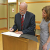 Lunenburgs Chairman of the Board of Selectman Jamie Toale signs the Community Compact with Lt. Governor Karyn Polito at the Lunenburg Library on Thursday afternoon, May 4, 2017. SENTINEL & ENTERPRISE/JOHN LOVE