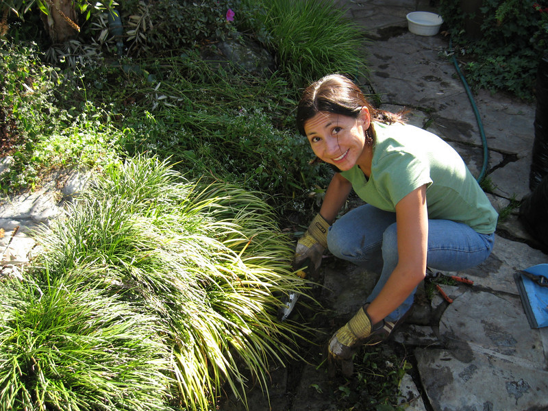 Claudia Vincent smiling, weeding at Claypools