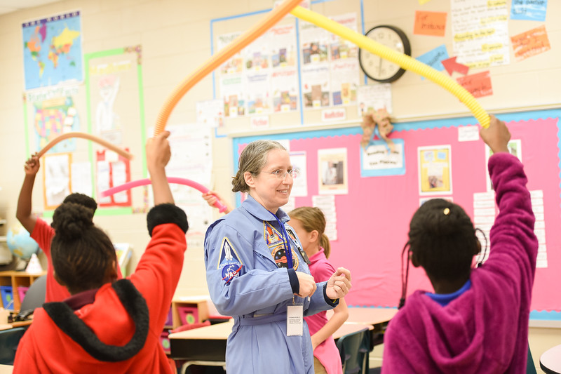 Professor of Theatre Beate Czogalla engages students at Lakeview Academy. Students learn about the psychics of space through hands-on activities.