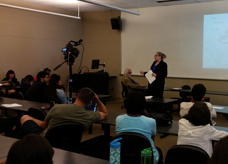 A speaker gives a presentation in the RFK Lecture Hall.