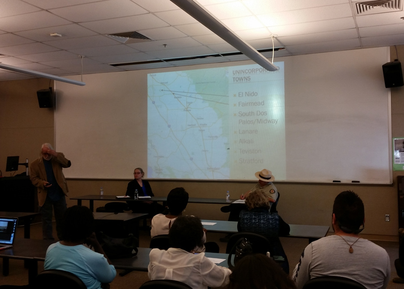 A speaker gives a presentation about unincorporated towns in the RFK Lecture Hall.
