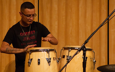 Student Manny Aldaco plays the congas during the jam session with Doug Wimbish.