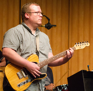 BC English professor Andrew Bond plays guitar in the jam session with Doug Wimbish and BC students.