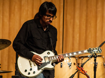 Miguel Mejia plays guitar in the jam session with Doug Wimbish.