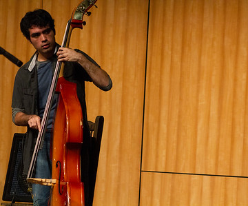 Josh Farria plays stand-up bass in the jam session with Doug Wimbish.