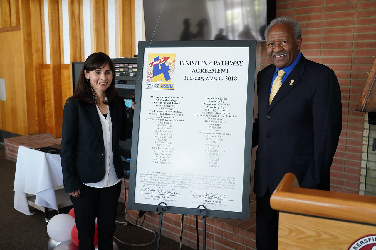 Sonya Christian and Horace Mitchel sign the Finish in Four agreement