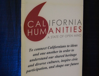 The sign for event sponsor California Humanities is displayed in the Forum.