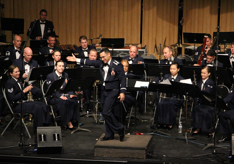 Captain Quinones, conductor, giving credit to the band.