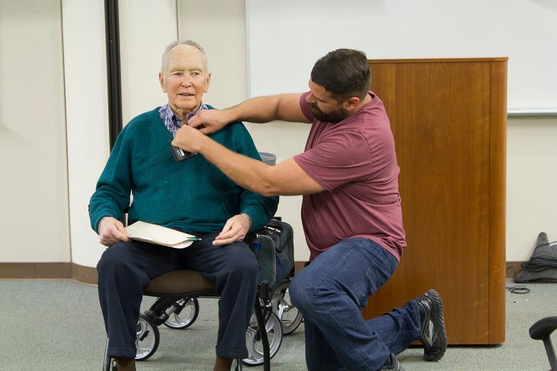 BC videographer Manuel De Los Santos mics up Gerald Haslam before his presentation in the Levan Center.