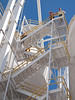 Bryce Lundberg and Carolyn are starting back down the tall silo stairway.  The two boys are mostly obscured at the next lower level.  100811_3021
