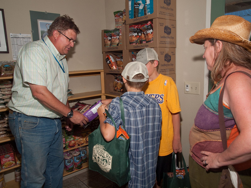 It was after 6 PM and Bryce was supposed to be home, but he couldn't let us get away without giving us Lundberg Family Farms canvas bags, which he filled with rice products they make.  We greatly appreciated Bryce's time and love of his work as an organic farmer.  100811_3184