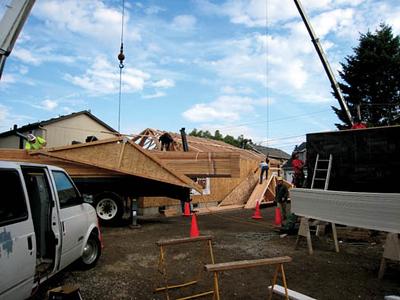 crane lifting facing of roof