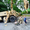 KRISTOPHER RADDER — BRATTLEBORO REFORMER<br /> Army Reserve Master Sgt. Ryan Kratt, from the Keene, N.H., unit, watches as Kale Grenon and Connor Martin, from the St. Michael's Catholic School's summer camp, in Brattleboro, Vt., operate the lift on a M978 Wrecker during Community Heroes Week on Tuesday, June 30, 2020.