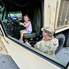 KRISTOPHER RADDER — BRATTLEBORO REFORMER<br /> Army Reserve Master Sgt. Ryan Kratt, from the Keene, N.H., unit, keeps an eye on Anna Otto, from the St. Michael's Catholic School's summer camp, in Brattleboro, Vt., as she sits in the driver seat of a M978 Wrecker during Community Heroes Week on Tuesday, June 30, 2020.