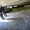 KRISTOPHER RADDER — BRATTLEBORO REFORMER<br /> Brattleboro Police Officers Ryan Washburn and Colby Kerylow came across inspirational messages written in chalk at the Flat Street Parking Garage, in Brattleboro, Vt., while walking around town to see how people are doing on Wednesday, May 6, 2020.
