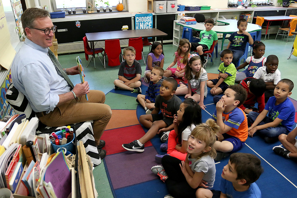 . Reingold Elementary School Community Reader Day was held on Thursday, June 15, 2017. The Sentinel & Enterprise City Editor Cliff Clark chats with kindergarten students in Jennifer Boudreau\'s class just before readng to them during community reading day at the school. SUN/JOHN LOVE