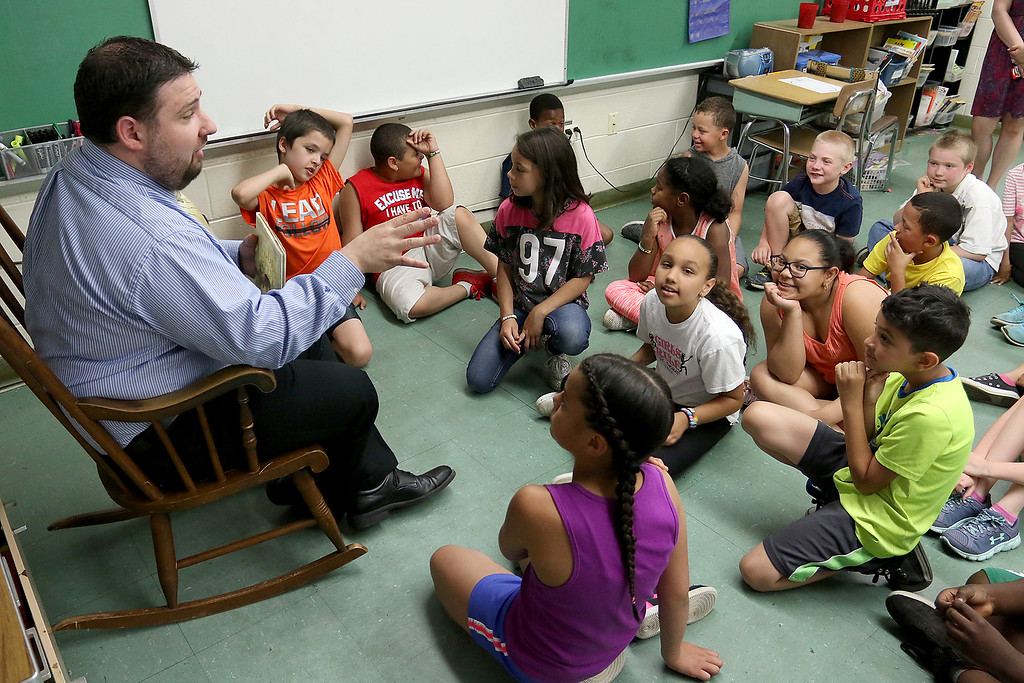 . Reingold Elementary School Community Reader Day was held on Thursday, June 15, 2017. Fitchburg City Councilor Marcus DiNatale talks to the third grade students in Sara DiNatale\'s class during community reading day at the school. SUN/JOHN LOVE