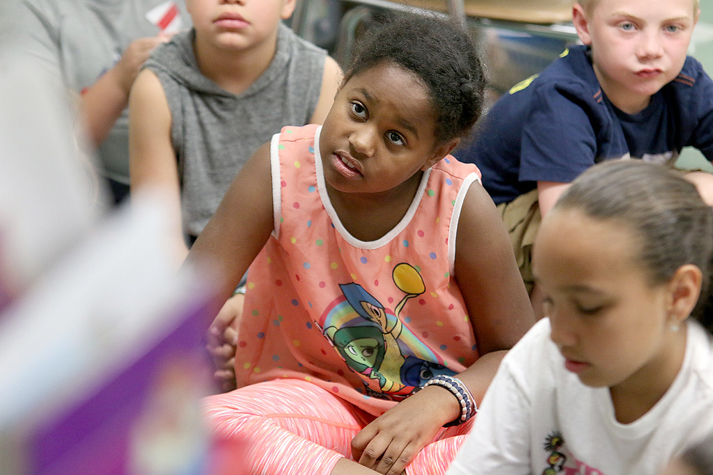 . Reingold Elementary School Community Reader Day was held on Thursday, June 15, 2017. Third grader Tanyra McCormack listens to Fitchburg City Councilor Marcus DiNatale during community reading day at the school. SUN/JOHN LOVE