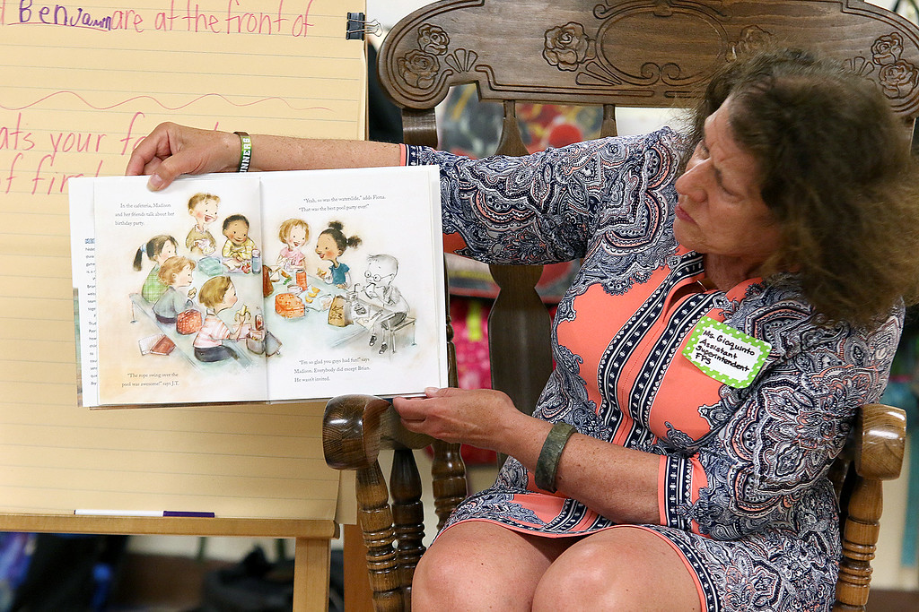 . Reingold Elementary School Community Reader Day was held on Thursday, June 15, 2017.  Paula Giaquinto the assistant superintendent of the Fitchburg Public Schools reads to Heather Dancause\'s first grade class during community reading day. SUN/JOHN LOVE