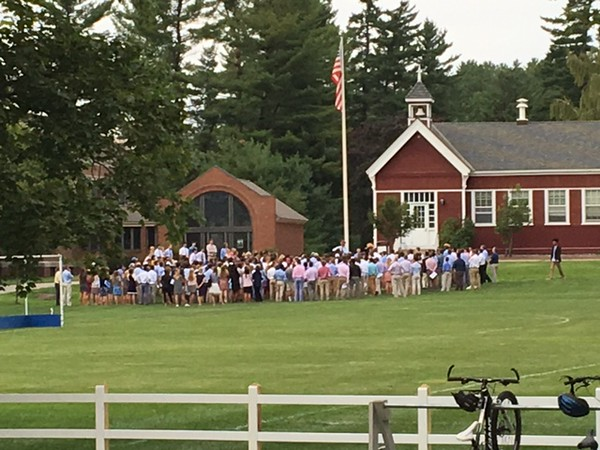 Students gather around the flagpole for the first Thursday Chapel of the year.