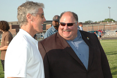 USC Pete Carroll and KU Mark Mangion chat for a moment.