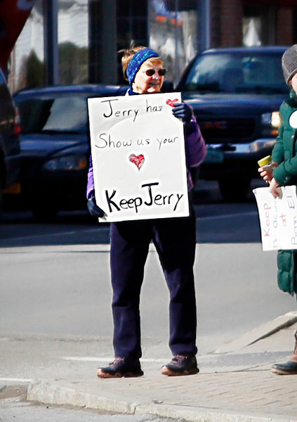HOLLY PELCZYNSKI - BENNINGTON BANNER Charlene Adams holds a sign in support of Jerry O'Connor at the four corners of Bennington on Monday afternoon during a protest demonstration to promote the rehiring of the former principal.