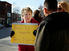 HOLLY PELCZYNSKI - BENNINGTON BANNER Carol Morin, Secretary at Bennington Elementary school holds a sign in support of Jerry O'Connor at the four corners of Bennington on Monday afternoon during a protest demonstration to promote the rehiring of the former principal.