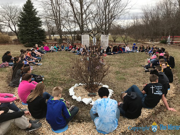 "​ROSARY—Students formed a human ""rosary"" and prayed the rosary at the end of the community service work day at Sacred Hear​t Parish, Webb City. (<i>The Mirror</i>)"