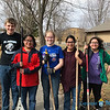 ​SERVICE DAY—​Students in St. Peter the Apostle Middle School, Joplin, recently spent a day in service ​dedicated to cleaning up​ the Prayer Garden at Sacred Heart Catholic Church in Webb City​, including planting tulip bulbs, removing leaves, and debris​. (<i>The Mirror</i>)