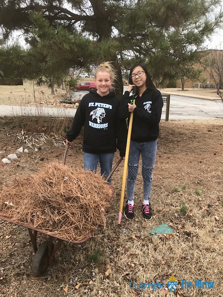 LEAF REMOVAL—Students in St. Peter the Apostle Middle School, Joplin, recently spent a day in service the first weekend of March in the Prayer Garden at Sacred Heart Catholic Church in Webb City. (<i>The Mirror</i>)