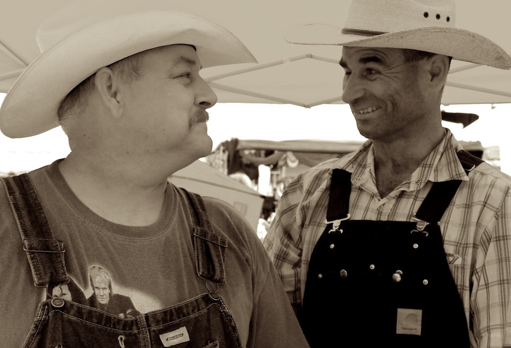 """Cliff Ashlock, left, and Shane Theissen did a brisk business with their """"Hillbilly Chili"""" at the fifth Annual Camarillo Chili Cook-Off and Country Music Festival.<br /> Asked if costuming and booth decor was a factor in the voting, Theissen adjusted the copper coil to his faux """"chili still"""" and remarked, """"It couldn't hurt""""."""
