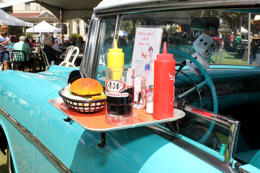 Complete with authentic car hop tray and fuzzy dice, Dick Kutin's '57 Chevy stands ready to serve.