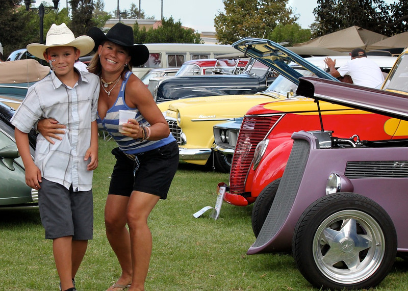Yvonne Lyon and son Jackson promenade on the front lawn of Camarillo Ranch, which played host to more than xxx classic automobiles.