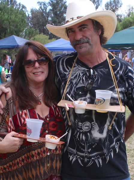 "Sheri and Greg Montrose of Simi Valley go ""hands-free"" at the 2012 Camarillo Chili Cookoff  and Country Music Festival.  <br /> All stock of Greg's patented Chili-n-Beer platform sold out at the event, leaving connoisseurs free to snap their fingers to live country music, and run their clean fingers over the bodies of a score of classic automobiles displayed at the event."