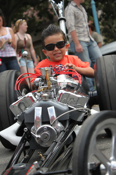 Four-year-old Landon Lopez of Camarillo tools around the CC&C in a custom dragster designed by his dad Phil of Crown Custom, Inc.