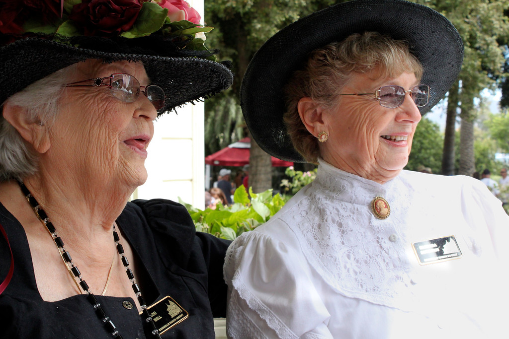 Dressed gracefully in Victorian fashion, Camarillo Ranch volunteers Lou Bell and Barbara Burrows view the Festival from the shady porch of Adolfo Camarillo's 120-year-old family home.