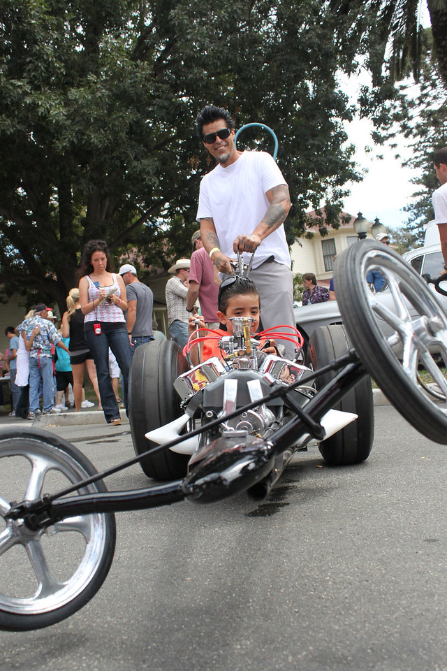 Some four-year-olds have a stroller.  Landon Lopez has hiimself a wicked-cool dragster.