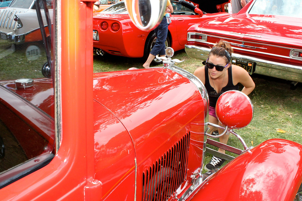 """Christina Lopez of Camarillo inspects the grillework of a 19xx Carname at the fourth annual Camarillo Chili Cook-off, Classic Car and Country Music Festival.<br /> A fan of hot rods and classic cars """"since I was a tom-girl"""", Ms. Lopez traded car stories and restoral techniques with owners of the xx vintage autos on display at the Labor Day event."""