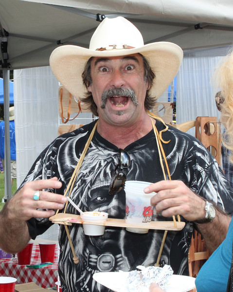 "Greg Montrose of Simi Valley goes ""hands-free"" with his patented Chile-N-Beer sampling neckwear at the 2012 Camarillo Chili Cookoff  and Country Music Festival."