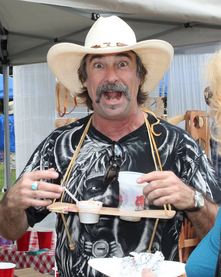 """Greg Montrose of Simi Valley goes """"hands-free"""" with his patented Chile-N-Beer sampling neckwear at the 2012 Camarillo Chili Cookoff  and Country Music Festival."""